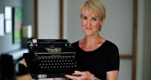 Catherine Cleary with her Underwood typewriter, bought at the monthly flea market in Newmarket Square in Dublin for €60. Photograph: Aidan Crawley