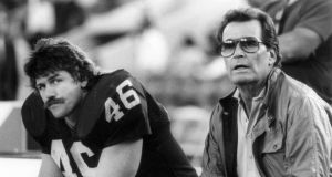 Los Angeles Raiders tight end Todd Christensen and actor James Garner on the bench during game against  Cleveland Browns at Los Angeles Memorial Coliseumin Los Angeles. Photograph:  Vic Milton/Getty Images