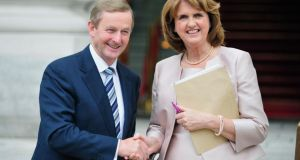 Taoiseach Enda Kenny and Tanaiste Joan Burton outside government buildings earlier this month. File photograph: Aidan Crawley