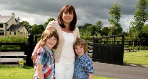 Deirdre Fallon Sheehan, from Ballymahon, Co Longford, with her sons, Murray (7) and Devin (5). Photograph: Brian Farrell
