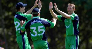 On his record 227th cap for Ireland, Andrew White celebrates taking a wicket  with Andrew McBrine, who took the catch, and Nick Larkin in the one-day game against Sri Lanka 'A' at Stormont in Belfast. Photograph:  Rowland White/Inpho/Presseye