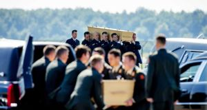 Dutch military personnel carry coffins containing victims of the MH17 plane crash at the airbase in Eindhoven. Photograph: Robin Van Lonnkhuijsen/EPA