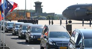 Hearses carry coffins containing unidentified bodies from the crash of Malaysia Airlines flight MH17 leave the airport  in Eindhoven, Netherlands.  Photograph:  Peter Macdiarmid/Getty Images