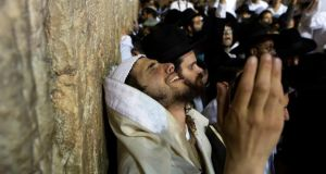 A Jewish worshipper takes part in a special prayer at the Western Wall in Jerusalem's Old City for the well-being of Israeli soldiers in Gaza today. Photograph: Siegfried Modola/ Reuters