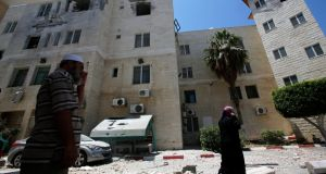 Palestinians inspect a damaged building of Al Aqsa Martyrs hospital after Israeli air strikes in Deir Al Balah town in central Gaza. Photograph: Mohammed Saber/EPA