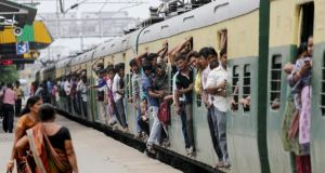 File photograph of  Indian passengers travel in a over crowded local train at Ballygunge station in Calcutta, eastern India. Photograph: Piyal Adhikary/EPA