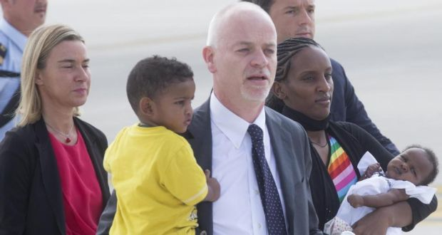 Meriam Yahia Ibrahim Ishag (3-R), from Sudan and her children, are welcomed by Italian minister for foreign affairs, Federica Mogherini (L) , Lapo Pistelli (C) and Italian prime Mmnister Matteo Renzi (R), after landing at Ciampino Airport on the outskirts of Rome. Photograph: Claudio Peri/EPA