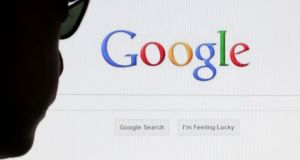 A computer user poses in front of a Google search page in this photo illustration taken in Brussels. Photograph: Francois Lenoir/Reuters