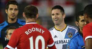 Robbie Keane of the Los Angeles Galaxy greets Wayne Rooney of Manchester United before the US side's 7-0 drubbing at the Rose Bowl. Photograph: Stephen Dunn/Getty Images