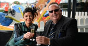 A day at the races: Judith Beckett and Rodger Connor. Photographs: Dara Mac Dónaill