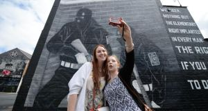 Weekenders: Claire MacSimoin and Andrea Flannagan snap a selfie at a loyalist mural in east Belfast. Photograph: Charles McQuillan/Pacemaker