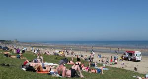 People enjoying the soaring temperatures at Portmarnock Beach in Dublin. Photograph: Collins