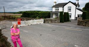 Roadworks:  Phil Butler outside her house. Photograph: Brian Farrell