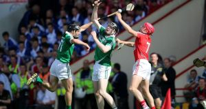 Cork's Lorcan McLoughlin with Limerick's Donal O'Grady and Declan Hannon  during the Munster final. Hannon can be a key figure for Limerick if he is used in a central position. Photo: Cathal Noonan/Inpho