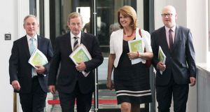 Minister for Jobs Richard Bruton, Taoiseach Enda Kenny Tanaiste Joan Burton  and Minister of State Gerald Nash gave a press conference today to publish the latest quarterly report on the Action Plan for Jobs. Photograph: Stephen Collins/Collins Photos