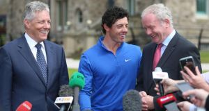 Rory McIlroy meets Northern Ireland's First Minister Peter Robinson (left) and Deputy First Minister Martin McGuinness (right) at Stormont Castle after winning the Open Golf Championship. Photograph: Niall Carson/PA Wire.