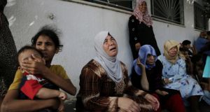 Displaced Palestinian women  cry after an Israeli airstrike hit their  shelter in a UN school, at Beit Hanoun hospital in the northern Gaza Strip, yesterday. Photograph: Adel Hana/AP