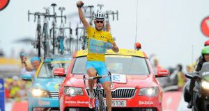 Overall leader Vincenzo Nibali of Italy celebrates as he crosses the finish line to win the 18th stage of the 101st Tour de France, over 145.5 km from Pau to Hautacam, yesterday. Nicolas Bouvy/EPA