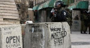 Occupied: Shuhada Street, in Hebron. Photograph: Hazem Bader/AFP/Getty