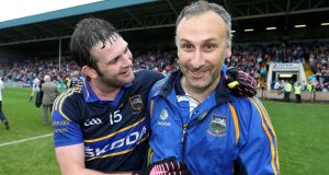 Tipperary's Barry Grogan celebrates with manager Peter Creedon after the victory over Laois at O'Moore Park. Photo: Cathal Noonan/Inpho