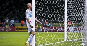 Zinedine Zidane walks into a goalpost in frustration after Italy goalkeeper Gigi Buffon had saved his header during the 2006 World Cup final at the Olympiastadion in Berlin. Photograph: Tom Jenkins