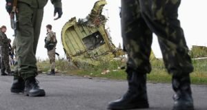 Crash site: armed pro-Russian separatists guard remnants of flight MH17. Photograph: Maxim Zmeyev/Reuters