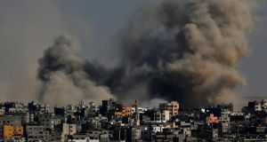 Smoke rises after an Israeli air strikes in the Al Shejaeiya neighbourhood during a military operation in the east Gaza City today. Photograph: Mohammed Saber/EPA