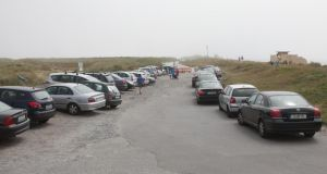 Cars parked near Dollymount Strand earlier this week. Photograph:   Collins