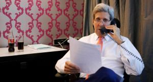 US secretary of state John Kerry speaks on the phone to Israeli prime minister Benjamin Netanyahu about the terms of a ceasefire in Israel's fight against Islamist militants in Gaza, from his hotel suite in Cairo today. Photograph: Reuters