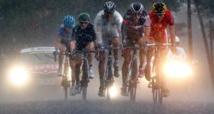 A group of breakaway riders pedal through a rain storm near the town of Condom in the Pyrenees mountains during the 19th stage of theTour de France cycling race between Maubourguet and Bergerac.Photograph: Jacky Naegelen/Reuters
