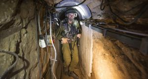 An Israeli soldier during a media tour organized by the army of a tunnel said to be used by Palestinians for cross-border attacks, on the Israel-Gaza border yesterday. Photograph: Jack Guez/Pool via The New York Times