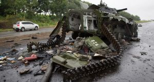 A destroyed pro-Russian APC near the city of Slovyansk in eastern Ukraine. Photograph: AP Photo/Dmitry Lovetsky