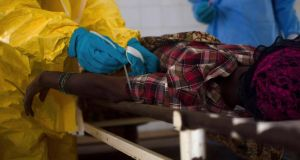 Medical staff take a blood sample from a suspected Ebola patient at the government hospital in Kenema in Sierra Leone. Photograph: Reuters