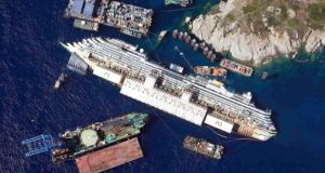 An aerial view shows the Costa Concordia on its side next to Giglio Island. File Photograph: Alessandro Bianchi/Reuters