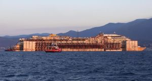 The  Costa Concordia in front of Genoa's port. Photograph: EPA