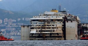 Wrecked  Italian cruise liner Costa Concordia in front of Genoa's port this morning. The Costa Concordia has arrived in Genoa, where dismantling operations are predicted to last two years. Photograph: EPA