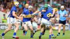 Dublin's John McCaffrey has nowhere to go as Pádraic Maher, Gearoid Ryan, Kieran Bergin and Brendan Maher close in during yesterday's All-Ireland quarter-final at  Semple Stadium, Thurles. Photograph: James Crombie/Inpho