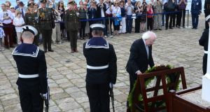 President Michael D Higgins laying a wreath on Howth Pier for the Asgard centenary celebrations. Photograph: Cyril Byrne