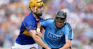 Tipperary's Kieran Bergin puts pressure on Alan McCrabbe of Dublin during their All-Ireland senior hurling championship quarter-final at Semple Stadium, Thurles, yesterday. photograph: James Crombie/Inpho