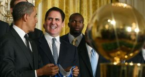 President Barack Obama and owner Mark Cuban participating in an event  at the White House. Photograph: Mark Wilson/Getty Images