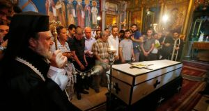 The funeral at the Saint Porfirios church in Gaza City yesterday of Palestinian Christian woman Jalila Faraj Ayyad, whom medics said was killed in an Israeli air strike. Photograph: Suhaib Salem/Reuters