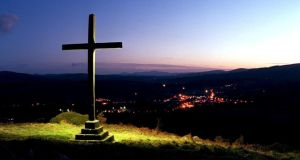 "Kerry councillors ""tired of apologising for their religion""– cross erected in 1950 and illuminated in 2000, overlooking Aughrim, Co Wicklow. Photograph: Jack McManus."