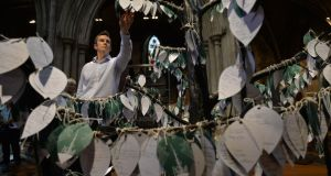 Andrew Smith,  education officer, at the  Tree of Remembrance in St Patrick's Cathedral. Photograph: Alan Betson