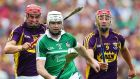 Limerick's Tom Condon shows Paul Morris and Lee Chin of Wexford a clean pair of heels in yesterday's quarter-final. Photograph: Cathal Noonan/Inpho