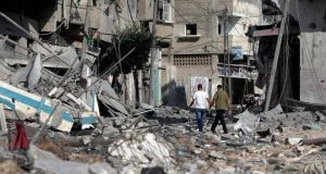 Palestinians walk amid the rubble of houses destroyed by Israeli strikes in Beit Hanoun, northern Gaza Strip, yesterday. Photograph: Lefteris Pitarakis/AP