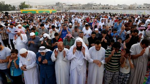 JORDAN: Palestinian refugees perform Eid al-Fitr prayers at Al-Baqaa Palestinian refugee camp, near Amman. Hundreds of refugees marched after the Eid al-Fitr prayers in solidarity with Gaza, calling for an end to Israel's military offensive. Photograph: Muhammad Hamed/Reuters