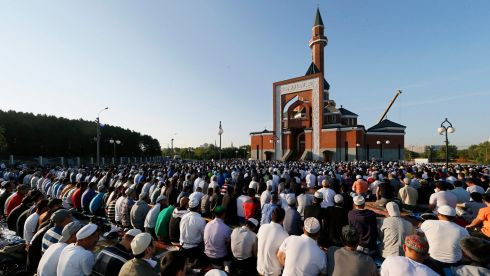 RUSSIA: Russian Muslims attend Eid al-Fitr prayers in front of a mosque in Moscow, Russia. Photograph: Yuri Kochetkov/EPA