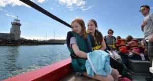 Grace (7) and Ellen (10) with their mother, Pauline O'Shea, on board the boat from Howth. Photograph:  Alan Betson