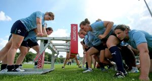 The Ireland women's rugby squad gets in some scrummaging during a training session at FFR headquarters at Marcoussis, Paris ahead of Friday's IRB World Cup clash against the USA. Photograph: Dan Sheridan