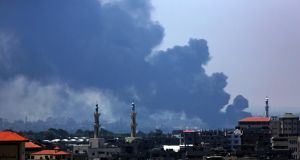 Smoke rises from Gaza power plant after an apparent Israeli air strike. Photograph: Mohammed Saber/EPA
